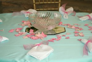 Scattered rose petals and floating candles are easy centerpieces