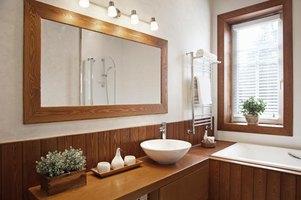 How high should i hang a bathroom mirror ehow for How high should a bathroom vanity be