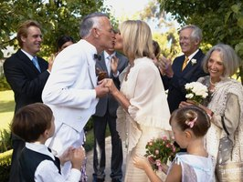Wedding Gift Etiquette 3rd Marriage : mature couple kissing at a wedding.