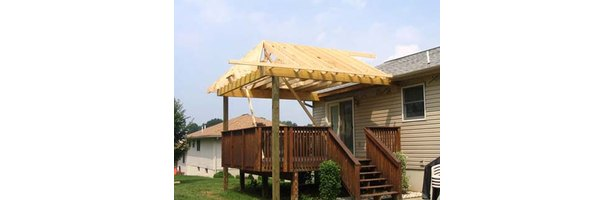 Build a roof on your deck to enjoy your outdoor space regardless of ...