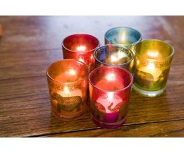 What is the significance of lighting a candle ehow for Votive candles definition
