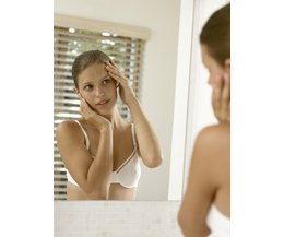 Teen looking at reflection in mirror (Photo: Pixland/Pixland/Getty ...