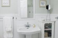 Cover the bottom half of the bathroom walls with wainscoting.