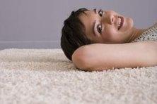 Cover dark flooring with a light carpet to brighten a dark apartment.