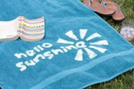 How to Customize a Beach Towel with Bleach