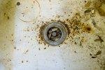 How Do I Repair a Farmhouse Kitchen Sink?