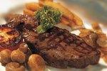 How Long Do I Cook a 1 1/2-Inch New York Strip Steak?