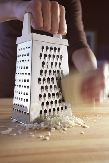 Cheese grater in use