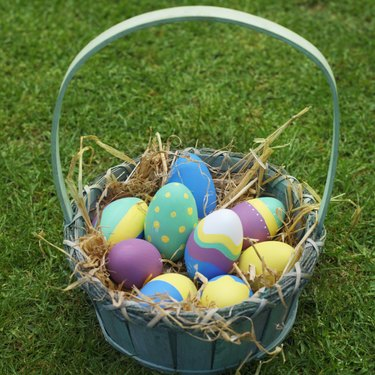 Elevated view of a basket filled with Easter eggs