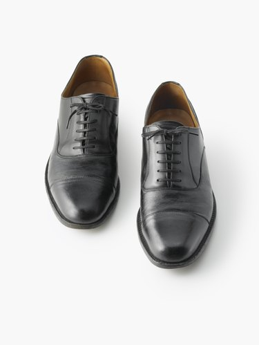 A Businessman's Shoes on a White Background
