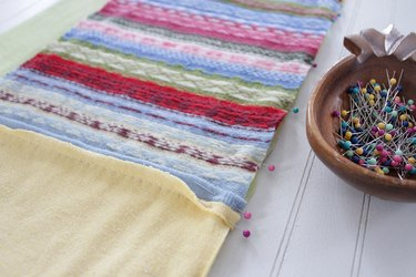 Snuggle up with a good book, a warm cup of tea, and your favorite jammies under this upcycled sweater quilt that you made yourself.