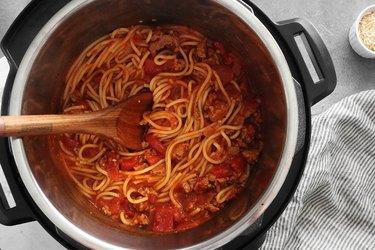 Stir spaghetti and let sit