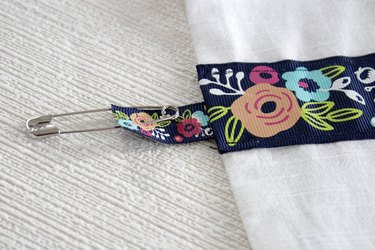 Instead of just hanging your towel over a cupboard door or throwing it on the counter, add a little ribbon to the top so you can give it a place of honor in your kitchen and hang it from your oven door.