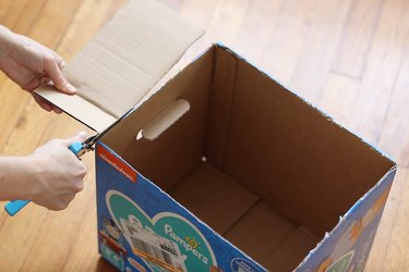 Cutting off flaps from top of diaper box