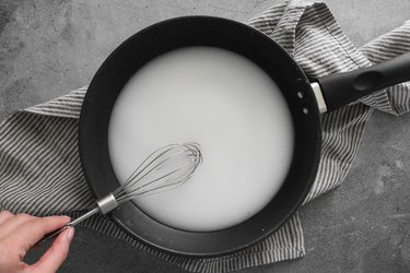 Whisk together water and cornstarch