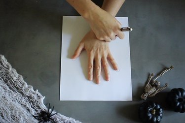 Tracing hand on paper