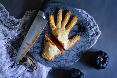 Severed hand meat pie