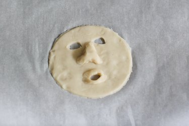 Shrunken head features shaped into dough