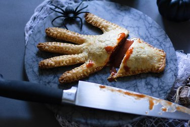 Severed hand meat pie with hot sauce