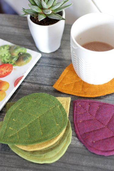 Bring that colorful fall feeling inside your home by creating a few vibrant felt coasters to protect your coffee table from those steaming cups of hot cocoa you'll be sipping.