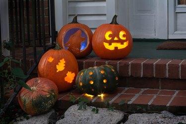 Five pumpkins on porch steps