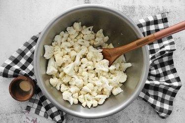 Toss cauliflower with oil, salt and pepper