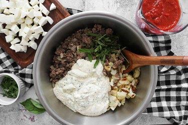 Combine baked ziti ingredients