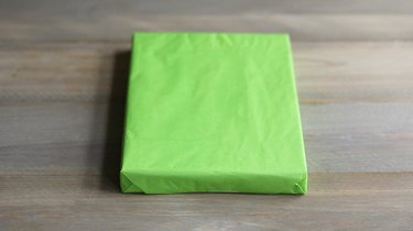 Gift box wrapped in green tissue paper