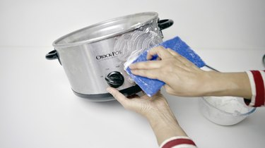 Using DIY gentle cleansing paste for slow cooker on outer pot.