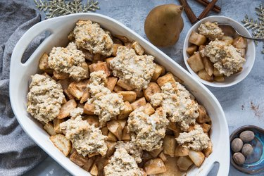 Casserole dish and bowl of pear cobbler