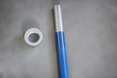Bottom of mailing tube wrapped with duct tape
