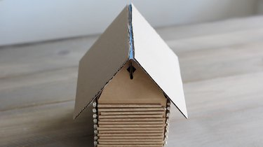 """Cake board """"roof"""" placed on top of gable box"""