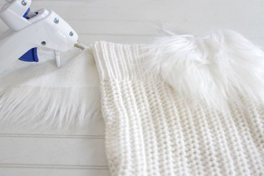 Instead of throwing out those sweaters that may have gotten a bit snug or gone out of style, you can give them a cozy new life as a Christmas decoration.
