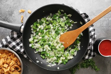 Cook onions and peppers