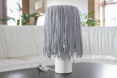 Find a few old t-shirts that have been hanging around your closet and create a whimsical fringe shade.