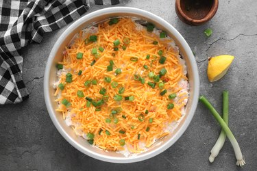 Top with cheese and scallions