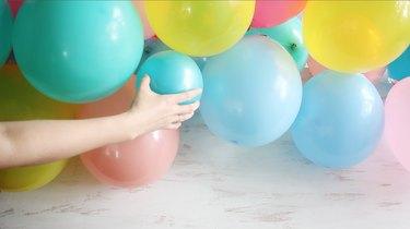 gluing smaller balloons to larger balloons