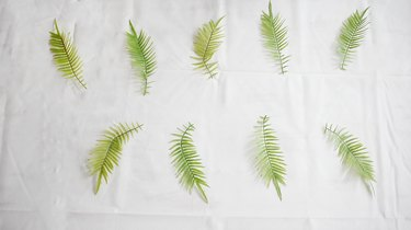 faux green leaves on table