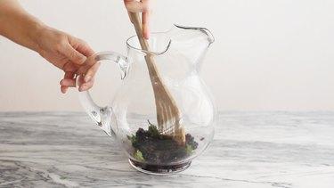 Muddling blackberries and mint