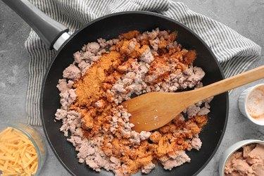 Add taco seasoning and broth