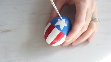 Painting Captain America's shield on Easter egg