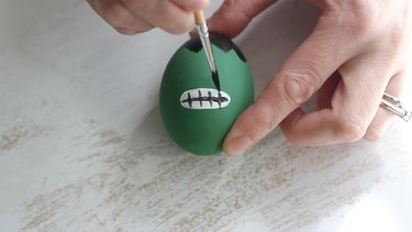 Painting The Hulk's teeth on Easter egg