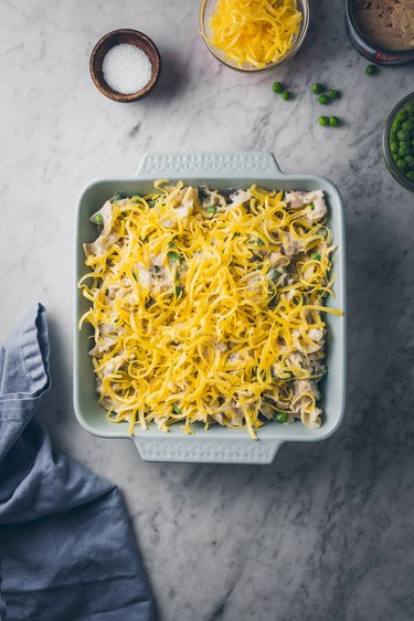 Topping with cheese