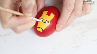 Painting Iron Man's mask on Easter egg