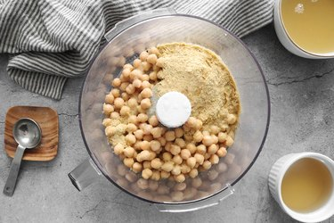Add solid ingredients to a food processor