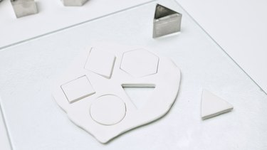 Cutting out polymer clay with cookie cutter
