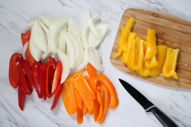 Slice onions and bell peppers