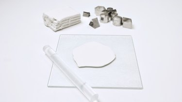 Rolling out polymer clay for cutting