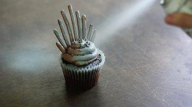 Spraying cupcake silver