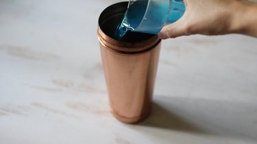 Pouring blue curacao into shaker